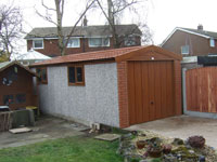 9' wide golden oak woodthorpe with metro tile roof and openi